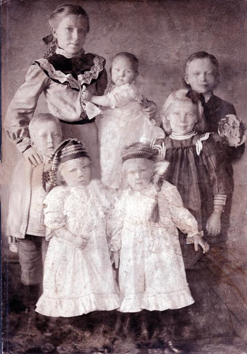 In age order: Elma, Emil, Ann, Wally, twins: Jean and Julie, and the baby Esther --1903
