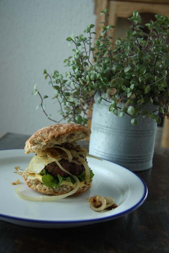 grass-fed beef burger with onion and aoili