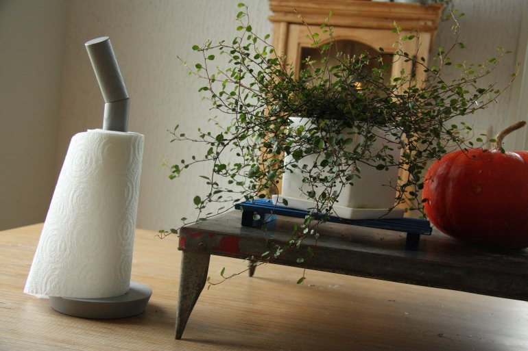 hay papertowel holder and flower stand