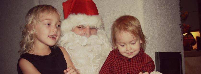 Sitting on santa's lap joulupukki
