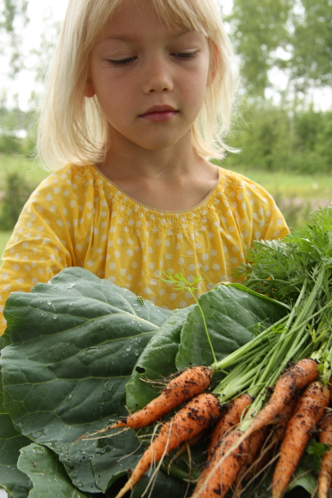 girl and organic garden produce